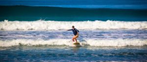 teen surfing in costa rica