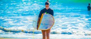 Laura Surfing in Costa Rica holding firewire surfboard